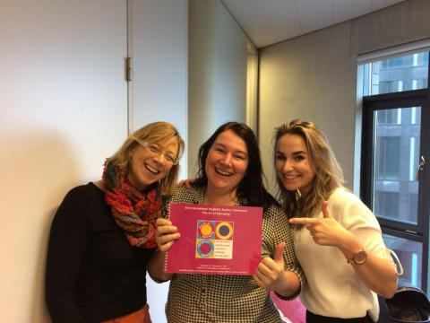 Sofie Sergeant, Irene van Helden and Noëlle van den Heuvel with the congress book in their hands